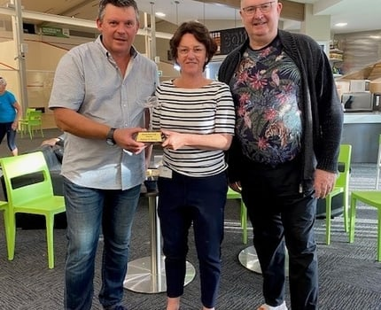 Susan Devoy presents Bruce with the winners Trophy, Mike Petrie arranges a re match and lessons from Susan !!